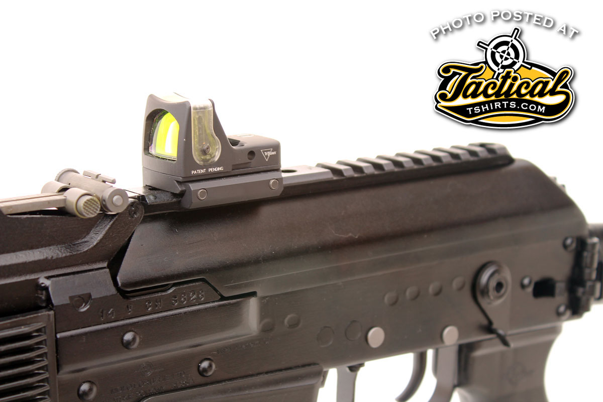 A synthetic Picatinny-type rail runs the full length of the receiver cover making it easy to mount a red dot sight.