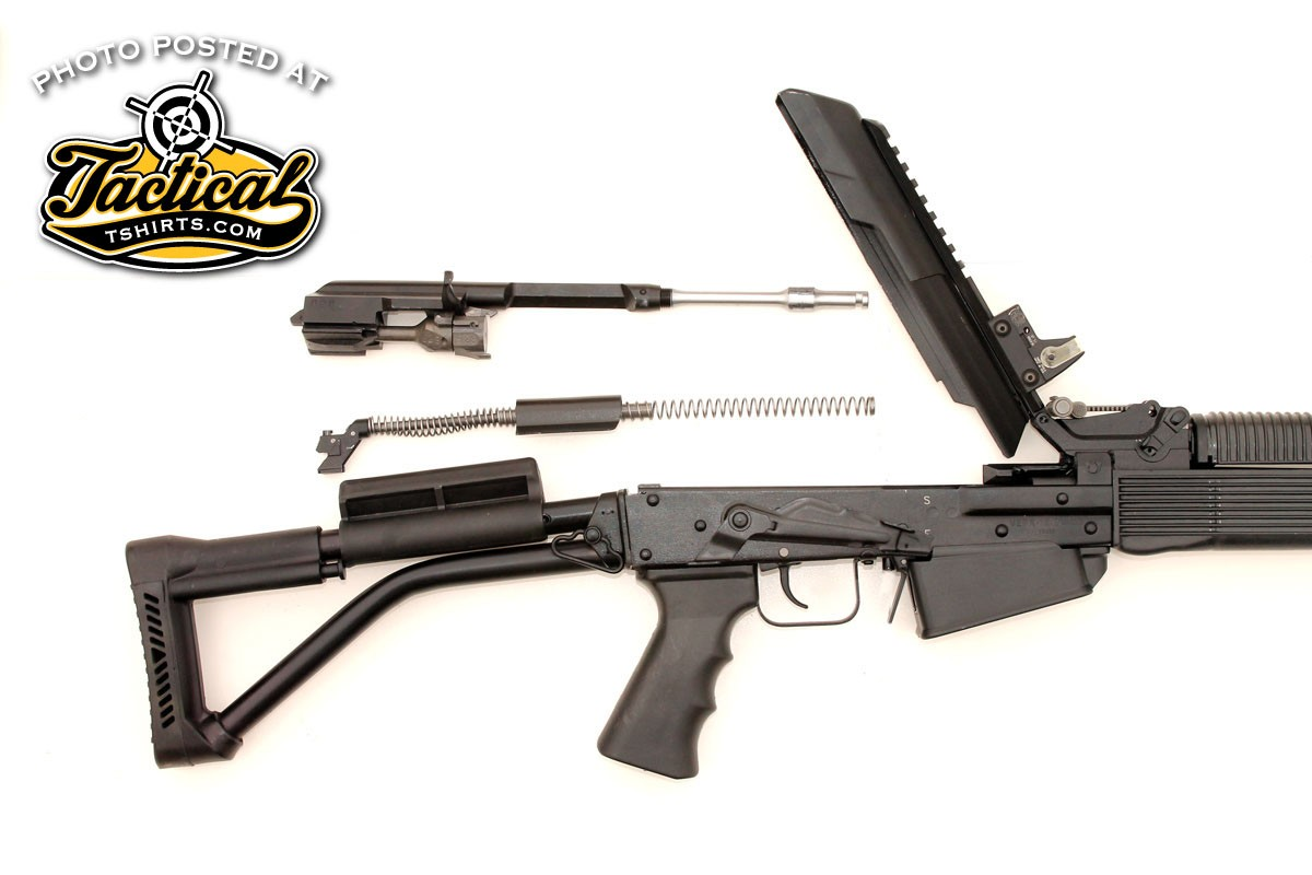 The Vepr-12 is as simple to take down as any AK. Tip up the receiver cover then remove the recoil spring and the bolt/piston unit to clean the bore and flush the hammer/trigger mechanism.