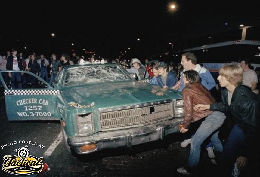 Sporting event riot. Our younger readers don't appreciate how heavy that car is.