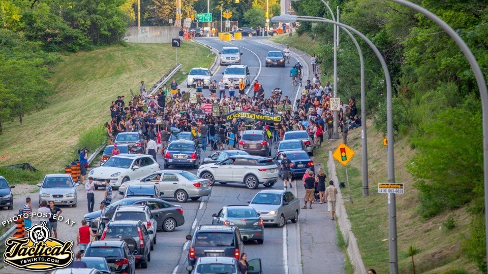 No traffic laws in a riot. Don't sit there to see what happens. leave!
