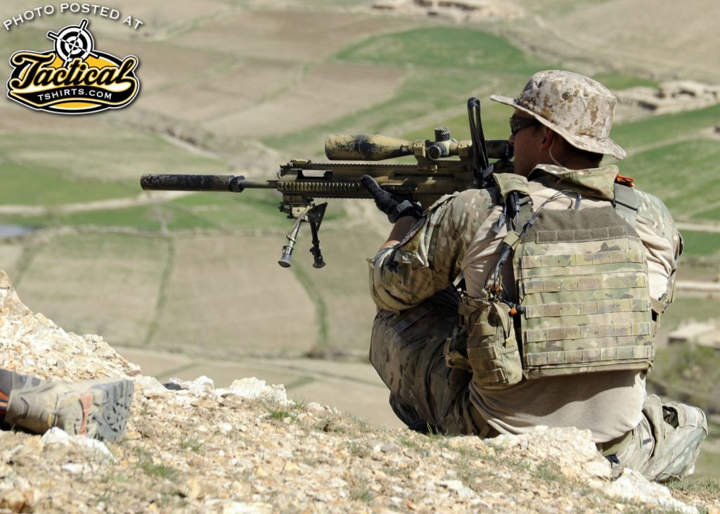 A coalition Special Operations Forces member fires his sniper rifle from a hilltop during a firefight near Nawa Garay village, Kajran district, Daykundi province, Afghanistan, April 3. Coalition SOF partners with the 8th Commando Kandak to conduct operations throughout Daykundi, Uruzgan and Zabul provinces. (U.S. Navy photo by Mass Communication Specialist 2nd Class Jacob L. Dillon / Released)