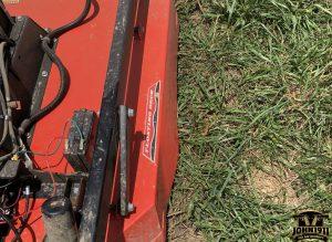 Broken DR 52T Bush Hog. Barbed Wire Jammed Up