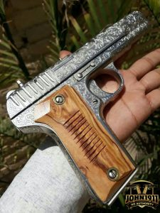 14 shot, engraved, double-stack, Khyber Pass copy of a Tokarev pistol. Made in Pakistan.