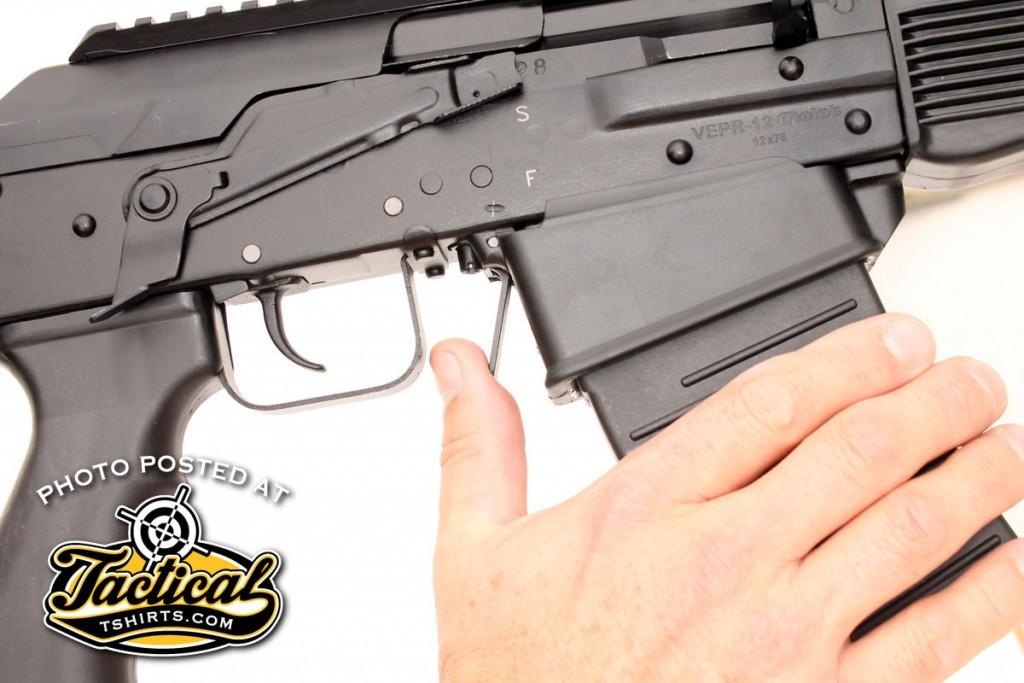 The mag well allows magazines to go straight in and out instead of having to be rocked in nose-first. Empty magazines drop free when the mag release is pressed.