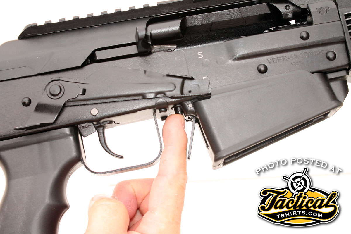 A small button between the front of the trigger guard and the magazine release is the manual bolt hold open. The bolt also locks open automatically after the last shot.