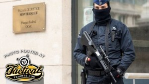 Belgium Police Officer with AUG. Notice the brass deflector.