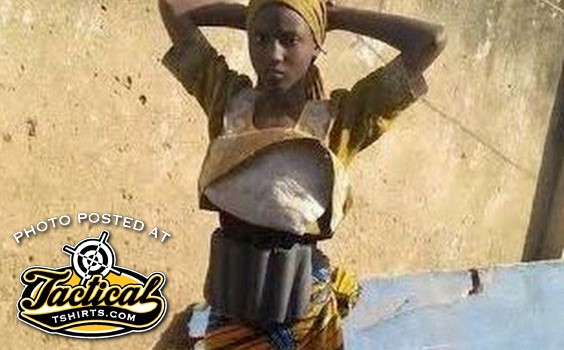 Female bomber captured in Africa. Notice how low the bomb sits on her body?