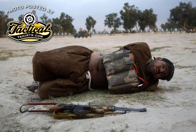 Suicide bomber in Afghanistan. Notice the DET cord and AK rifle.