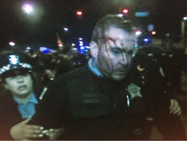 Hillary Clinton / Bernie Sanders supporters injure police officers.