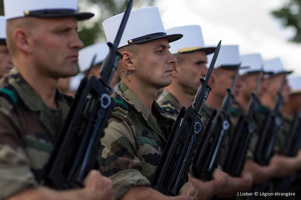 French Foreign Legion in traditional dress with FAMAS bullpup rifles.