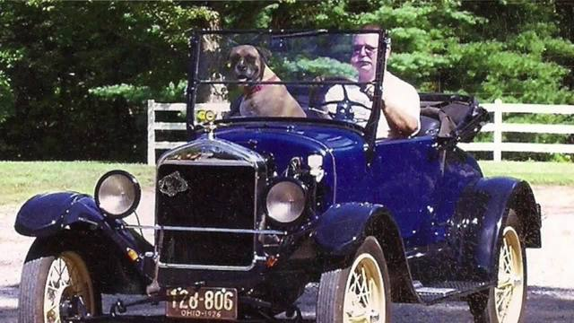 Jim Baker and his Shop Dog Ares driving in a local parade. He had a nice old car collection on the fabrication side.