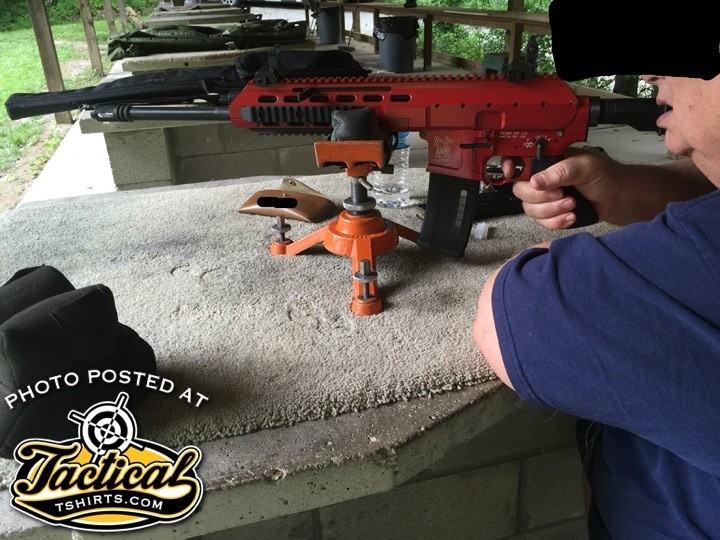 A friend shooting the ARES rifle off a bench.