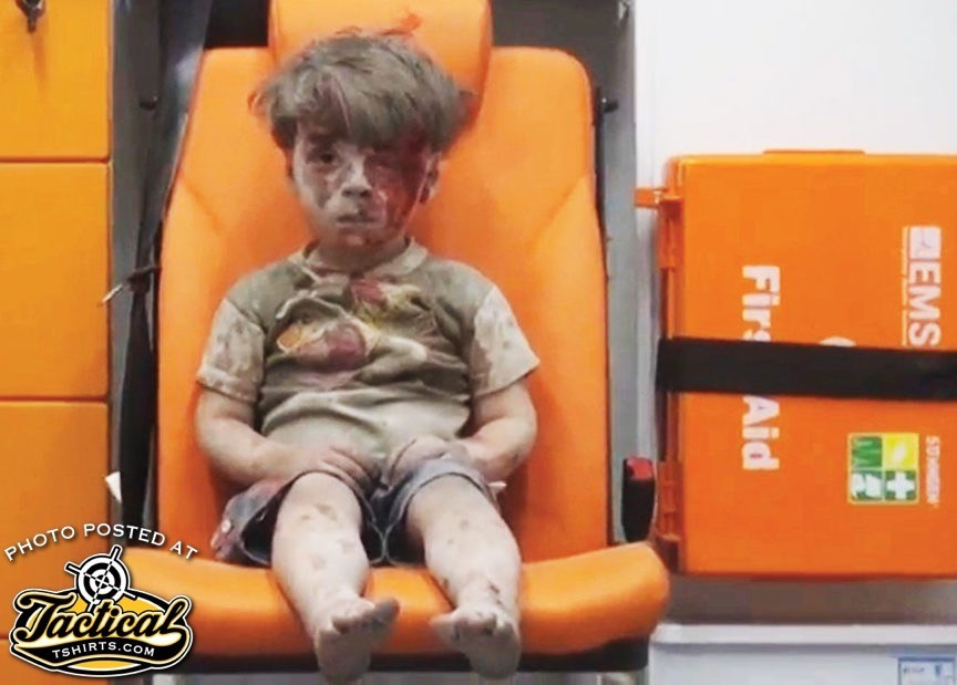 Infamous Syrian boy in ambulance after bombing.