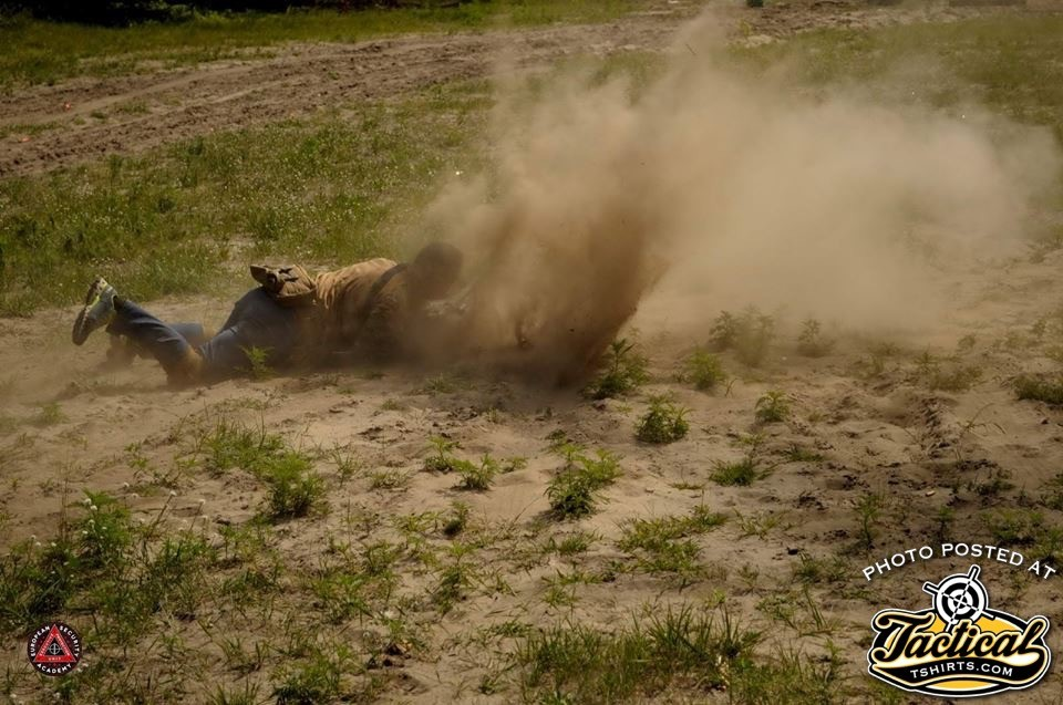 Student gets's AK rounds in dirt by instructor.